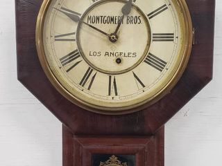 Antique Montgomery Bros  los Angeles Wood Wall Clock  made by Ansonia Clock Co  includes key   works   10 in  diameter clock face   22 in  overall height