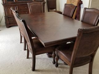 Dining table 29 1 2 x 78 1 2 x 48  leaf 24  pads and 8 faux leather chairs