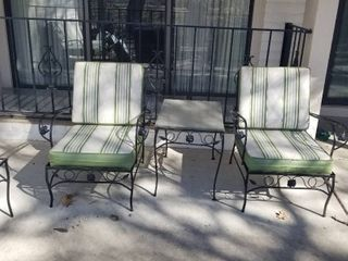 Wrought iron 2 chairs  cushions and small table