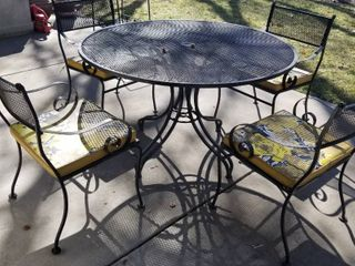 Wrought iron patio table and 4 chairs with cushions