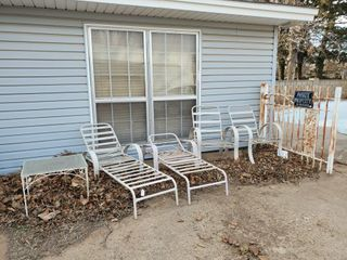 2   lawn Chairs  2  lounge Chairs    Table