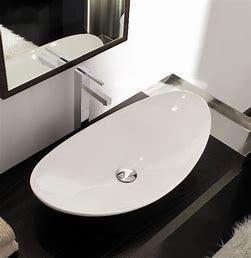 CB HOME Oval Ceramic Counter Top Vessel Sink