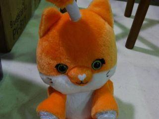 Orange Fuzzible Friend