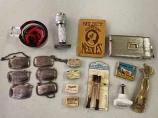 Misc lot  Sugar Packs  4  Silver Plated liquor Bottle Tags  6  Single Ashtray Horseshoe Pattern  Stahly Razor  Cigarette Case lighter With Watch Front  Needle Book