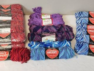 25 Skeins of Yarn  Red Heart   13 Shaded Red  6 Blues  2 Other blues  2 Kolor Match Evening Jewels and 2 Rug Yarn Amethyst