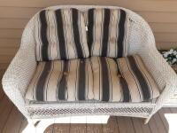 Wicker settee w cushions