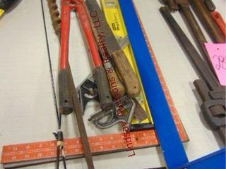 Group  bolt cutters  squares  level  file  machete