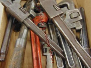 Flat of 11 pipe wrenches