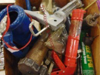 Box of grease guns  oil cans  caulk guns