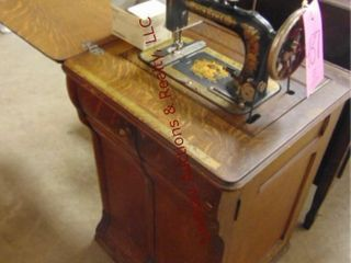 Vintage New Home sewing machine in cabinet