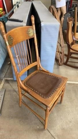 VINTAGE CHAIR WITH lEATHER SEAT AND BRASS DECO