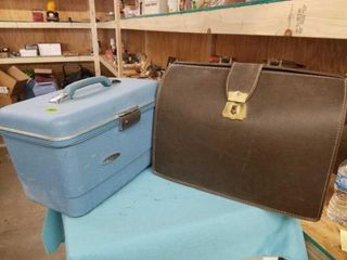 BlUE VANITY SUITCASE AND A SATUAl