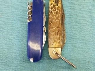 KNIFE AND A MUlTI TOOl KNIFE