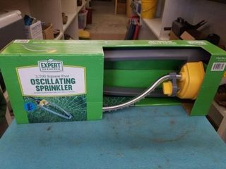 NEW IN THE BOX OSCIllATING SPRINKlER AND A