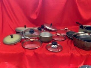 POTS   PANS AND MANY lIDS