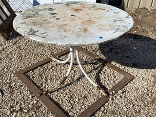 OUTSIDE METAl TABlE WITH FOUNDATION SO IT WONT