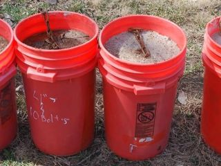 4   BUCKETS WITH CONCRETE   CHAIN