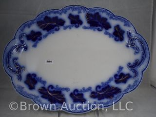 large blue and white platter  large leaves border