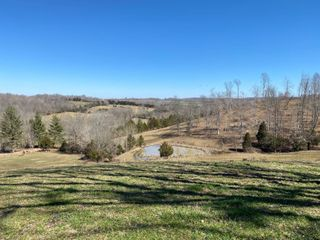 MONROE CO. HOUSE AND FARM SELLING IN 9 TRACTS