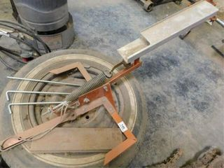 Clay target thrower and tire stand