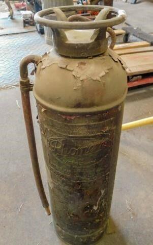 old brass fire extinguisher