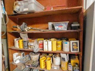 Wood shelf full of misc hardware