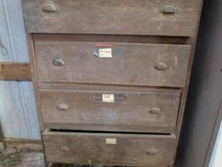 metal cabinet and a 5 drawer wood chest