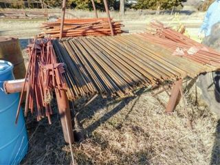 Pipe rack w approx  250 electric fence post