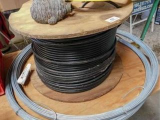 roll of black plastic coated cable