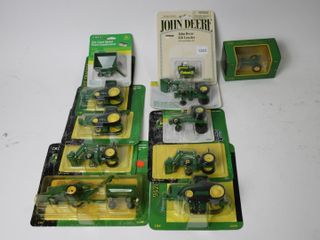 GROUP OF JOHN DEERE TRACTORS AND WAGON ERTl 1 64