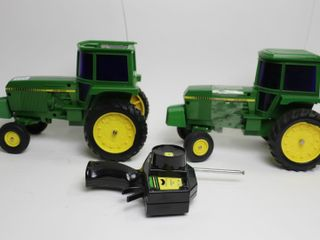 2 JOHN DEERE RC TRACTORS  ONE MISSING ROOF 1 16