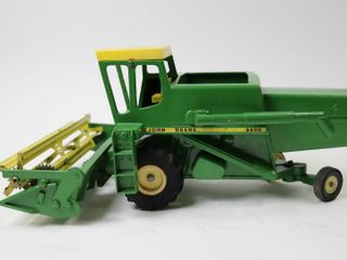 JOHN DEERE 6600 COMBINE WITH STEEl REAl HEAD