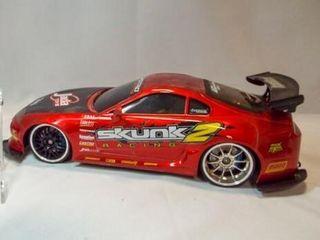 Jada Toys 1 10 Skunk 2 Racing Car  battery