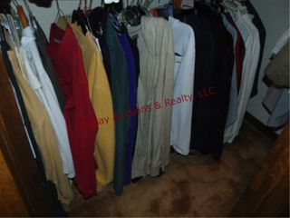 Group women s clothes  on bottom rack in closet