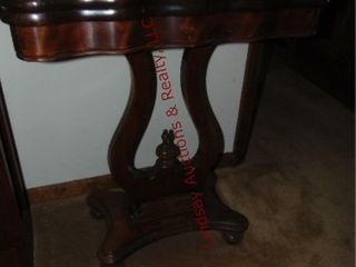 Wood table  top opens up and swivels