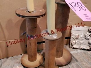 3 wood spool candle holders measuring 10  to 16