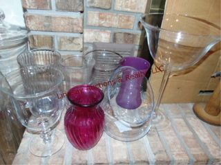 7 various size vases