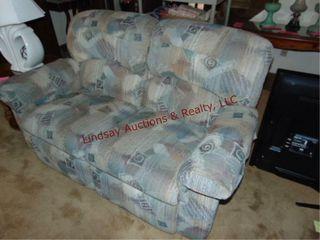 love seat  reclines  63 x 40 x 36