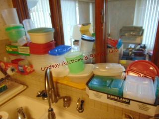 Group of plastic food storage containers  various