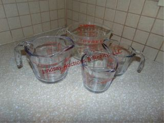 4 various size measuring cups  Fire King  Pyrex