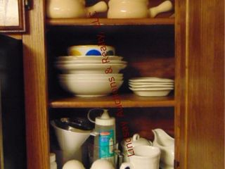 Group of dishes in cabinet  plates  bowls
