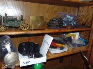 2 shelves of contents  cast iron tractor  bookends