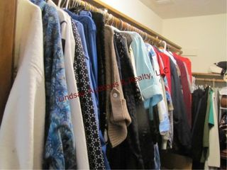 large group of women s clothes  shirts  sweaters