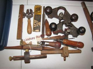 Group of vintage tools  story pole  hand vise