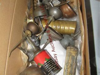 Box of vintage oil cans