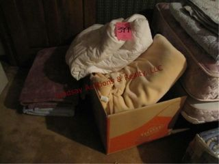 Group of used bedding  blankets  mattress pads