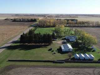 UNRESERVED REAL ESTATE & ACREAGE AUCTION FOR SARAH BANMAN & THE ESTATE OF ISAAC E BANMAN