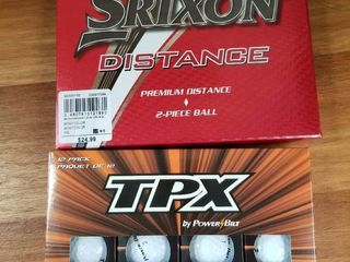 Two Boxes of Golf Balls  24 total