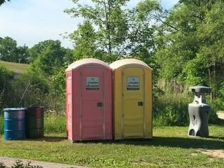 Two Portable Toilets and a Handwash Station   Perf