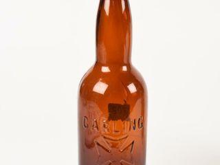 CARlING lONDON AMBER GlASS EMBOSSED BEER BOTTlE